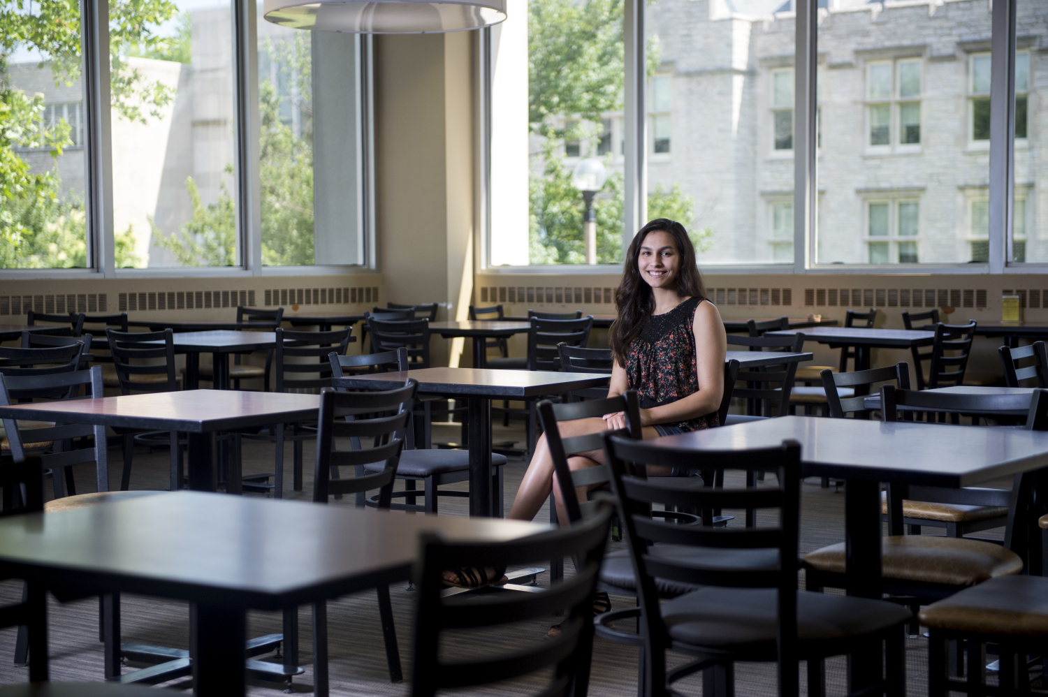 Amrit Bal sits in the Memorial Union lounge area at MU.