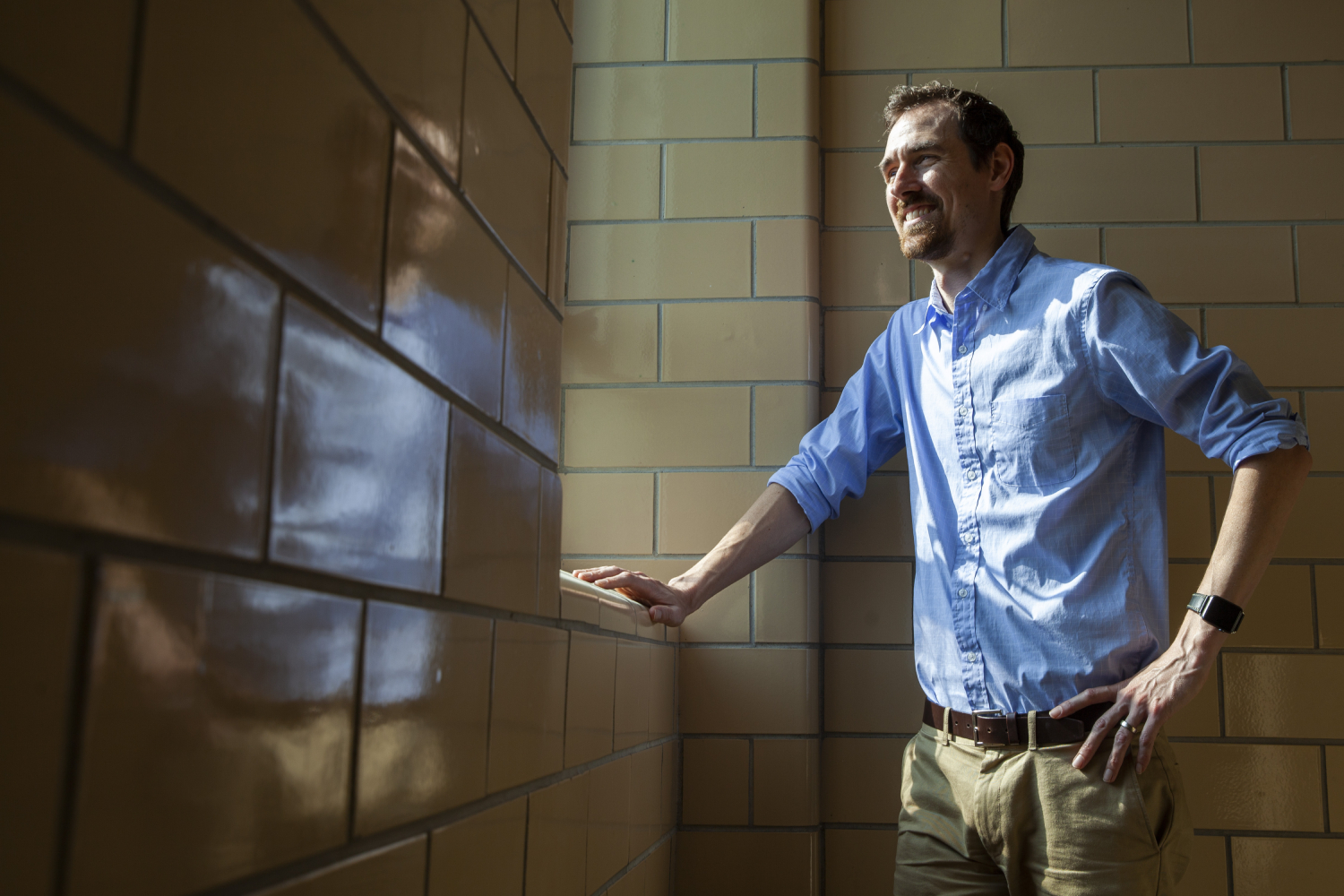 Erik Potter stands near a window in the MU Arts and Science building