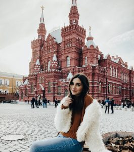 Portrait of Caroline Been in front of a historic building in Moscow