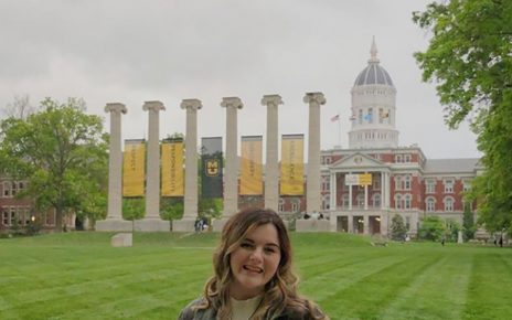 Karlee Resler-Seek stands in front of the Columns on Francis Quadrangle at the University of Missouri